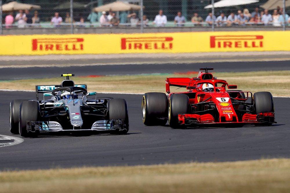 P 2018 Vettel passing Bottas | 2018 British GP copy.jpeg