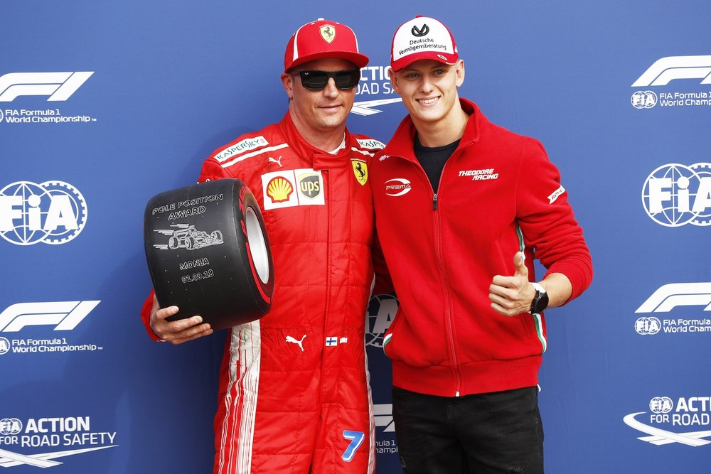 Z 2018 Kimi Raikkonen receives pole award from Mick Schumacher | Ferrari SF71H | 2018 Italian GP Q3 3 copy.jpg