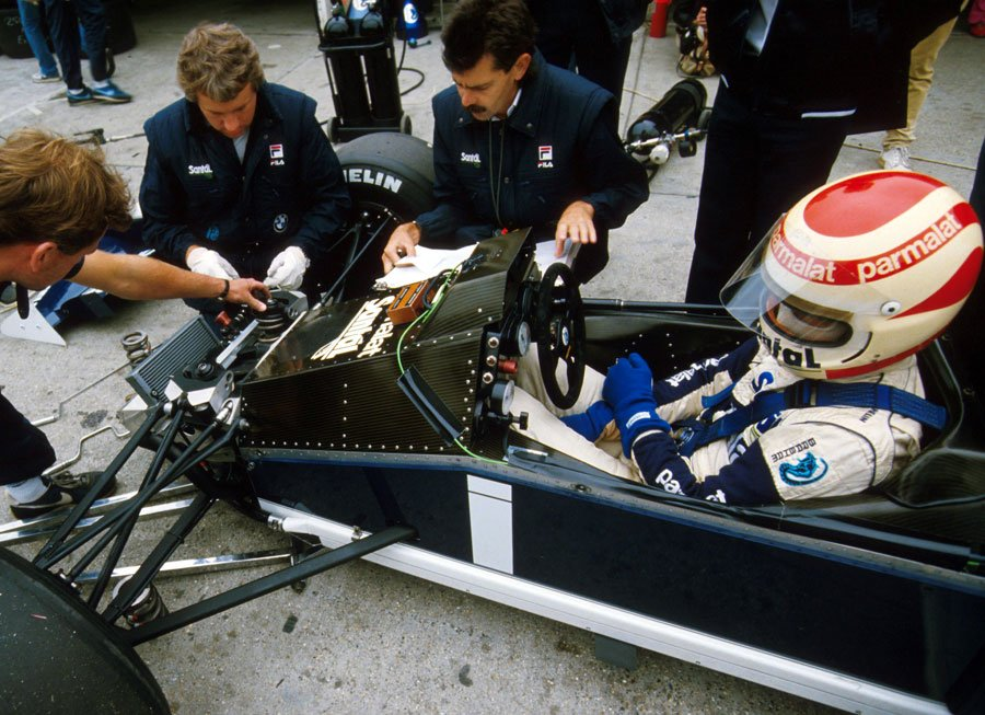 Charlie Whiting and Gordon Murray working on Nelson Piquet's Brabham at the 400th F1 race - the 1984 Austrian Grand Prix.