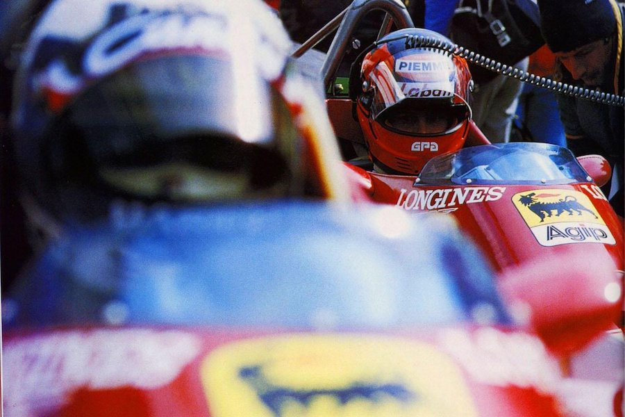 Gilles Villeneuve looking at teammate and competitor Didier Pironi.jpg