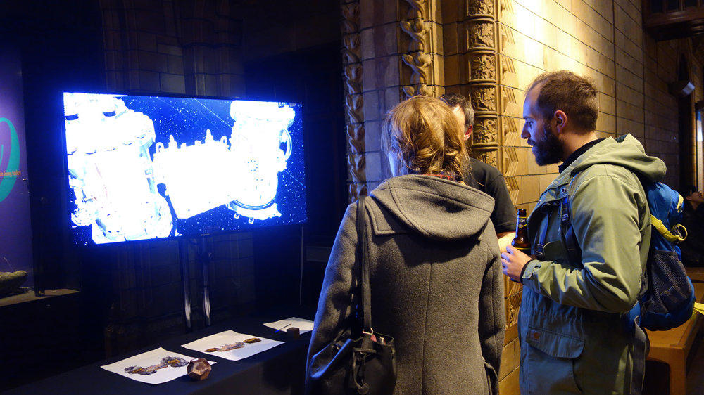 NHM visitors engaging with one of the science booth during a Late event