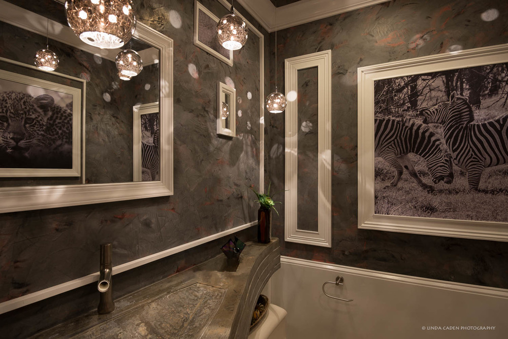 Powder Room--The walls are a Venetian Marble paint technique, with white rectangular applied molding to add interest to the walls. We decided to insert a few black & white Africa photos here--zebras fighting, a baby leopard, and eyes of a baby giraffe and little elephant. So somebody's watching you...