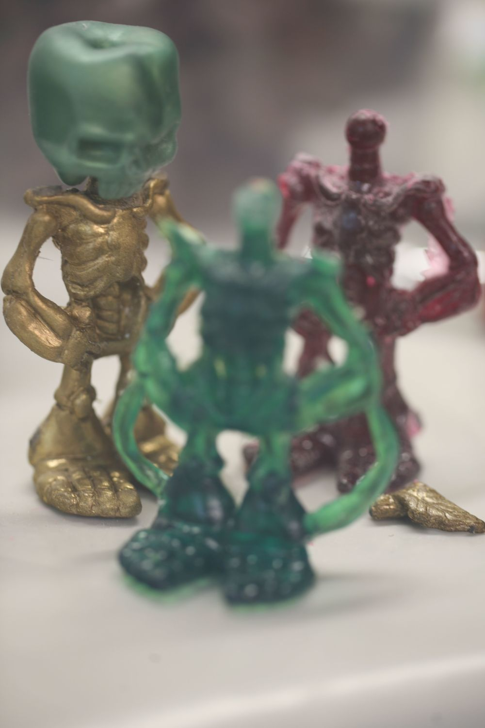 Green& gold figure plus headless bodies.jpg