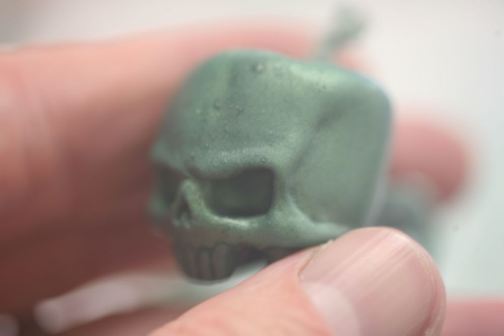 green skull in hand horiz-1.jpg