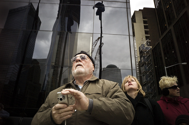 If you've ever taken a lunchtime stroll in Lower Manhattan, you've seen them: Sightseers (and locals, too) with their eyes raised skyward, watching the construction of One World Trade Center. Annoying to some, but revealing to photographer  Keith Goldstein —whose photo essay  Looking On  captures the craning.  Goldstein is a professional photographer who has worked in Lower Manhattan for years—he was there when the original WTC fell, and has watched its replacement slowly emerge over the past 13 years. In fact, it was on his own lunchtime walks around the neighborhood that he shot the series.   According to Goldstein , the photos aren't about tourists as much as they are the range of reactions that the new building evokes:  My intention was to capture a thought provoking collection of expressions, emotions, and the diverse ethnic make-up of the visitors. To see how they reacted to what they were seeing – a place where people perished and a new place that was being rebuilt out of the ruins.  The effect is a little like watching people watch a tennis game—there are a few truly vacant expressions, though even those are funny in their own way. But the really great thing about  Looking On  is how it captures something about a building—about  buildings —that an architectural photograph never could.