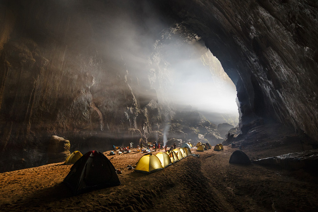 "Amazingly, Son Doong cave  was only discovered by locals in 1991 . British scientists surveyed the 5.5-mile-long cave in 2009, revealing a main chamber over three miles long, 650 feet high and nearly 500 feet wide, significantly surpassing the  previous record holder .   Guided tours of the cave  began in 2013, on a very limited basis:  only 224 people  will be allowed inside this year. Visitors enter by rappelling more than 250 feet to the cave floor, where they spend three nights camping inside.  Photographer Ryan Deboodt tells Gizmodo that shooting in the Son Doong cave felt like being in an alien environment. ""I always wanted to explore other planets and I think this might be the closest I can get to that experience,"" he says.  Shooting in such an alien, unreachable landscape has enormous challenges. ""The environment is tough in caves and nothing ever seems to go as planned,"" Deboodt told us. ""There is a lot of problem solving down there and so many points where it can go wrong: camera, triggers, flashes, bulbs, etc.""  The environment is daunting, but Deboodt uses those challenges to create magnificent images. ""Besides the light coming in through the entrances and holes in the ceiling, when photographing caves you have to create all your own light which can lead to out of this world photographs,"" he says."