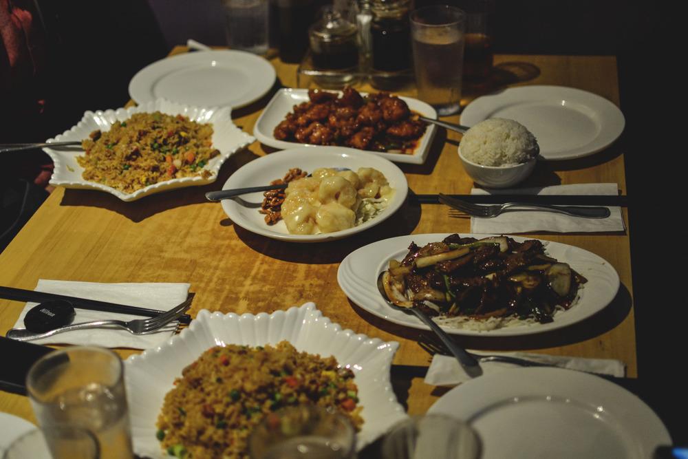 (Bottom to top) BBQ pork fried rice, BBQ pork fried rice,General Tao's Chicken, white rice, honey garlic prawns and Mongolian beef.
