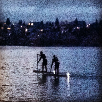 Paddle boarders, with what looked like candles on the back of their boards.