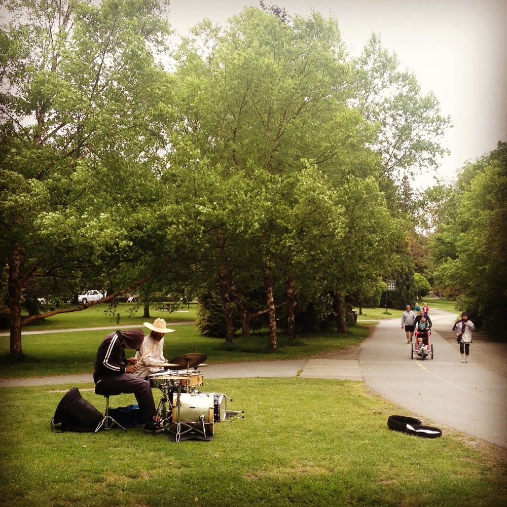 Two drummers playing mid-day at Greenlake in Seattle.