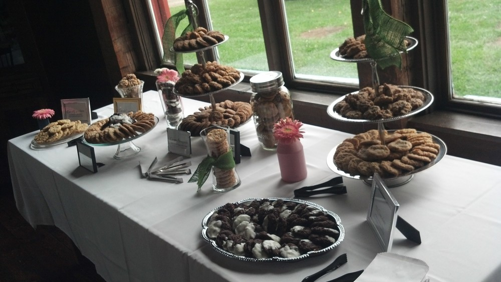 Cookie Bar with Six Different Flavors placed in Vases and Trays.  Name Cards for each Flavor are in different style frames to match the Country Chic the couple used so well.  Clean.  Neat.  So You!