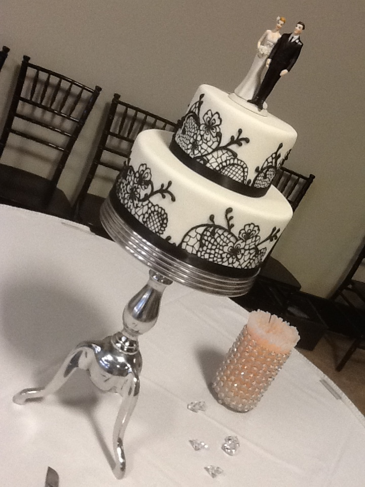 Elegant Black and White Fondant with Black Royal Icing Lace inspired by the bride's gown.