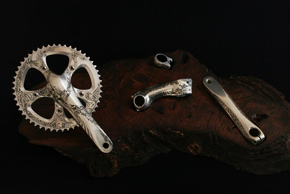 Group of Wabi Sabi Engraved , ash and clear coat on crank, stem and seat-post clamp on waxed wood 2010