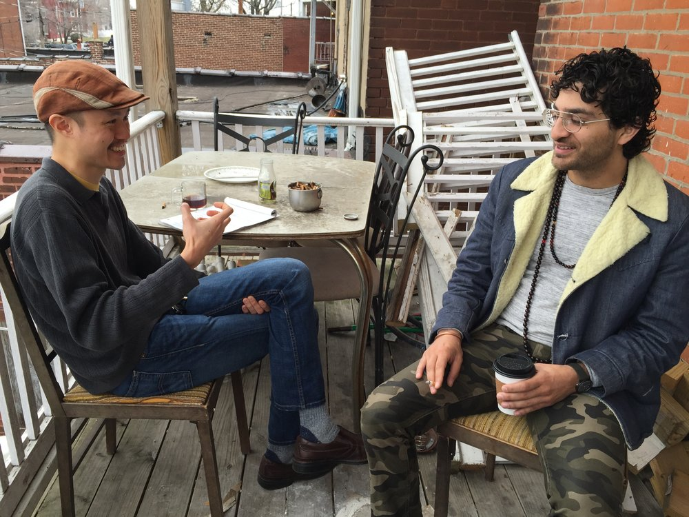 Jason (left) interviews Kaveh (right), proprietor of Blank Space, a café and gallery with a mission to provide employment for neighborhood residents.