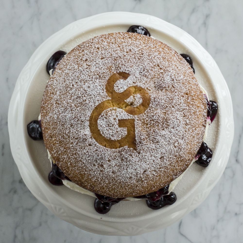 Blueberry Victoria Sponge Birthday Cake dusted with South Granville Inhabiter Logo © 2014 Helena McMurdo