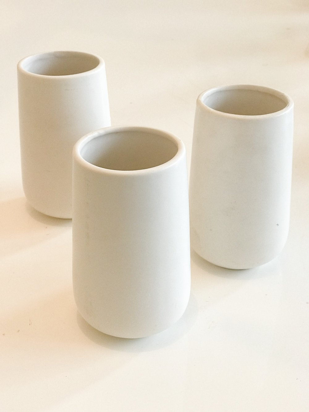 white cylinder vases