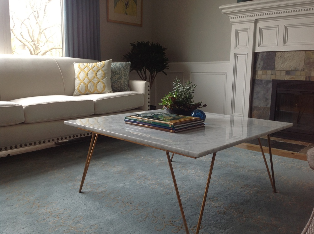 www.saranobledesigns.com  Don't you just love the marble coffee table?