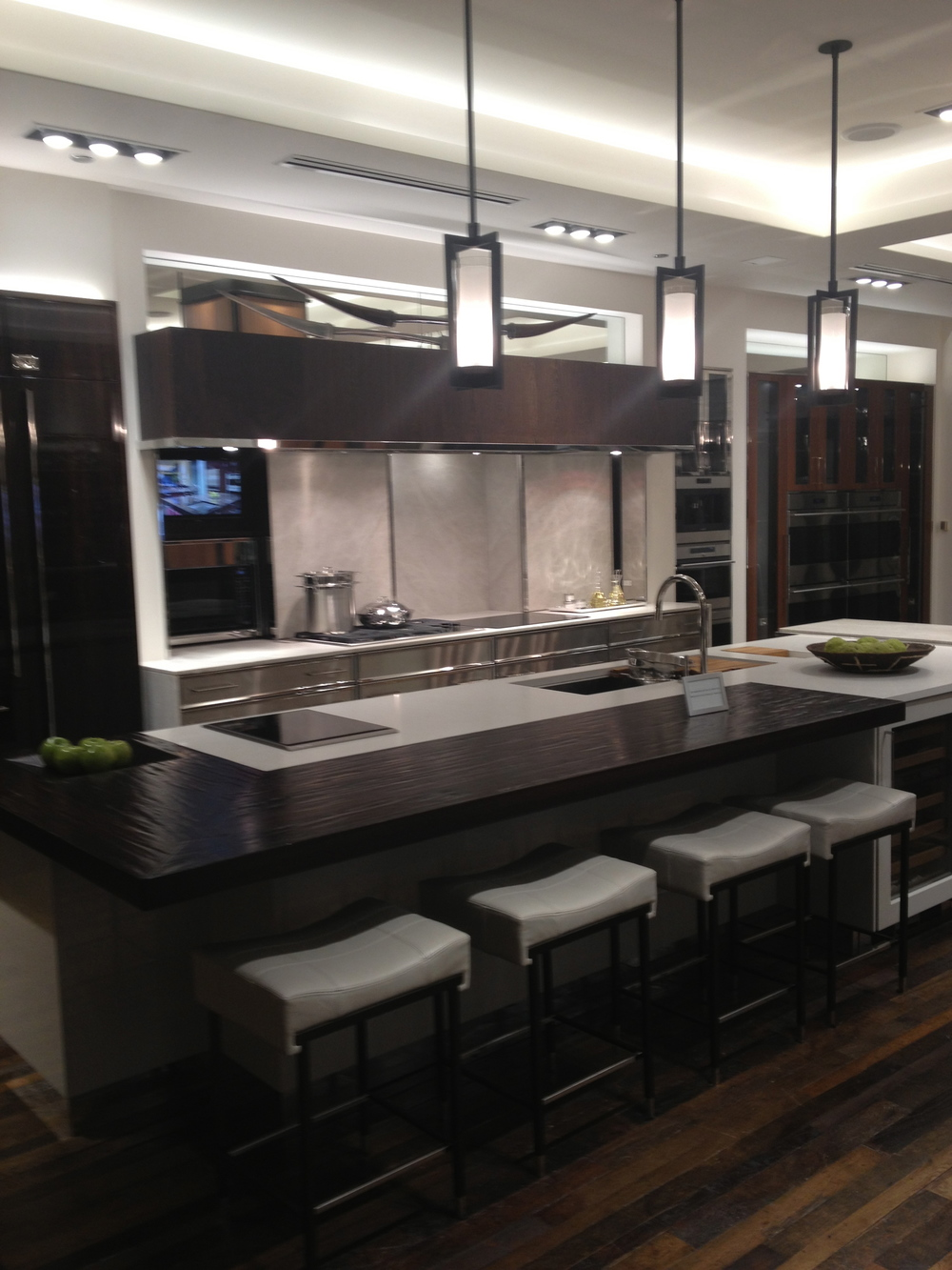 This showroom kitchen was not only practical but beautiful.  I love the mix of the  materials on the counter.