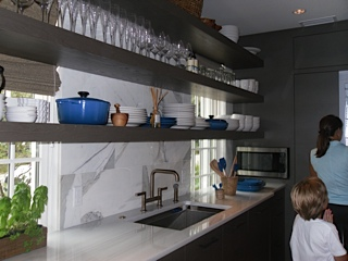 Open shelving with pops of blue accents.