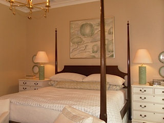 Master Bedroom with a neutral color scheme hinted with light green.