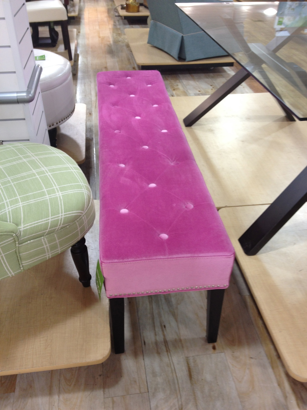 The length of this bench caught my eye.  It's a hard color for many spaces, although it could be awesome.   If fuchsia won't work with your decor this is a great piece to reupholster.  The length is perfect for a bench at the end of your bed.  Reupholstering a bench is fairly easy project to coordinate.