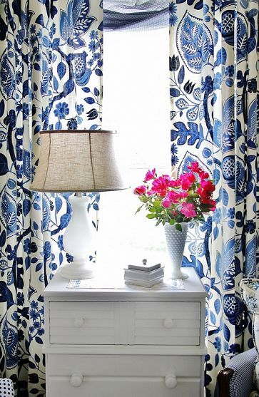In honor of our Kansas City Royals and their winning streak, minus tonight, I'm blogging blue!  Love the blue pattern on these drapes.     http://www.hometalk.com/586640/need-an-easy-fix-for-a-blank-wall-add-a-wall-of-shutters/photo/116191