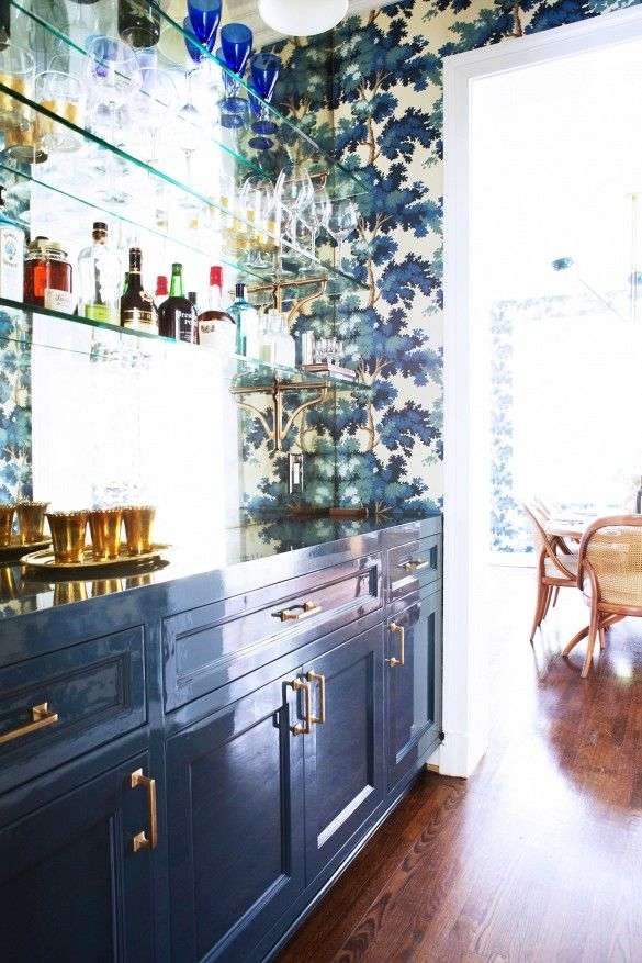 Love the blue cabinets and just the right amount of gaudy wallpaper.  http://www.domainehome.com/painting-tips/slide7  saranobledesigns.com