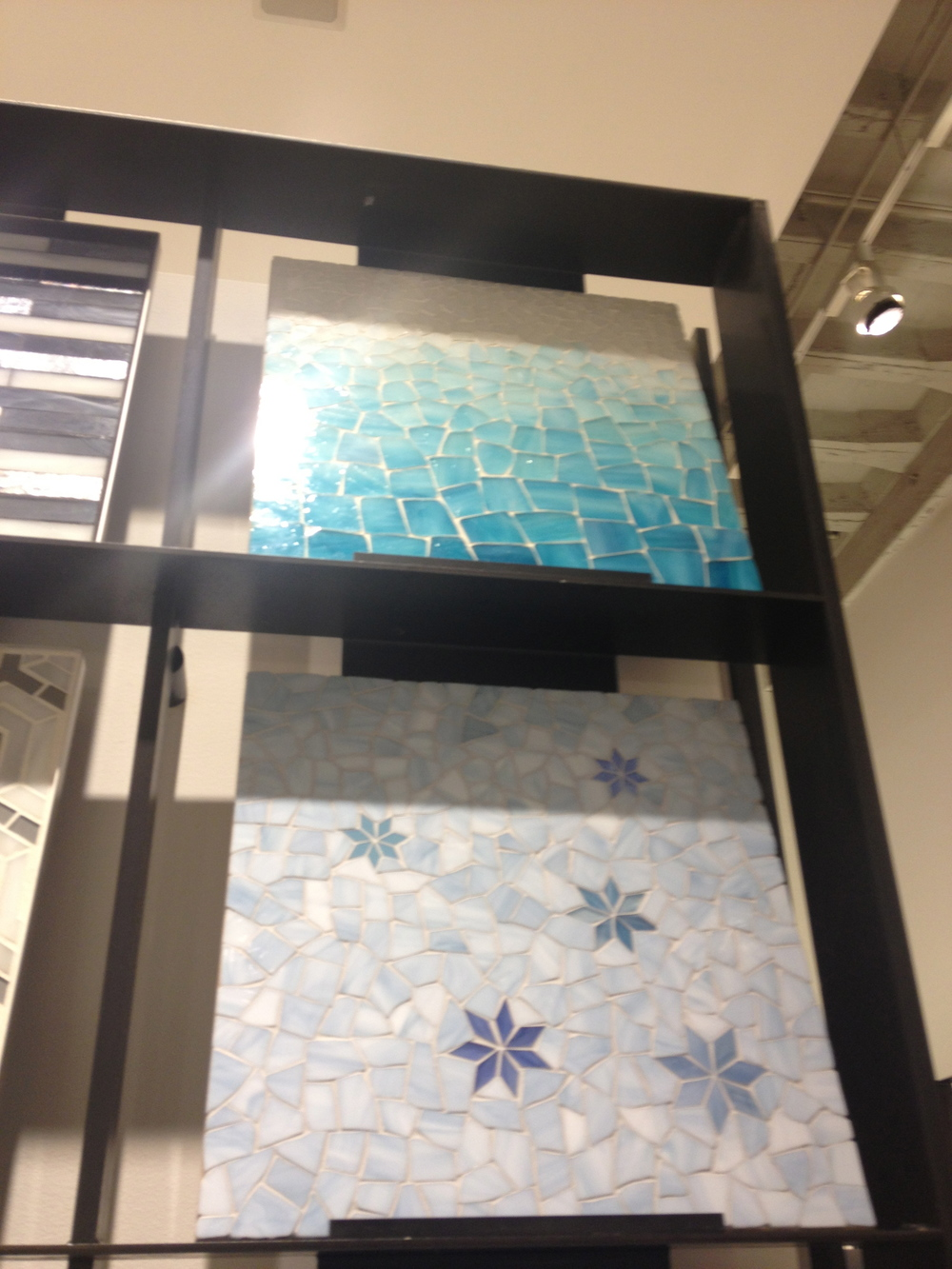 The ombre glass mosaic on tile is really unique.  www.saranobledesigns.com