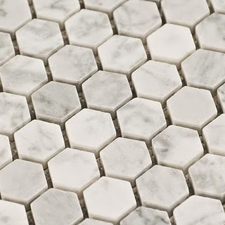 Ellie's floor tile is one of my favorite's.  The marble hex mosaic is classic and fun.  And turns out to be forgiving.  The natural coloring of the marble hides hair and dirt.
