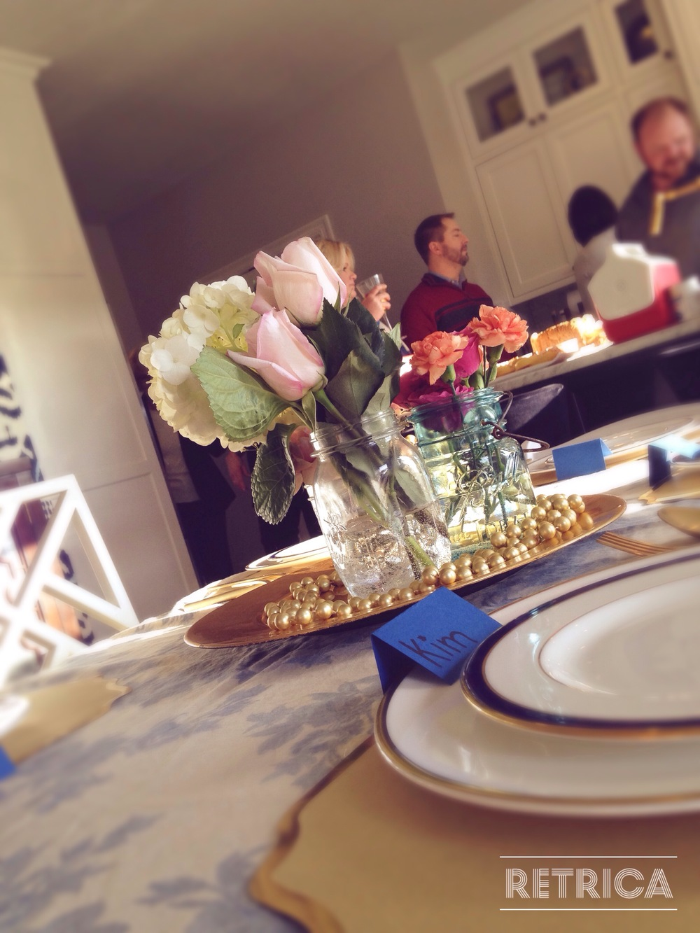 Ellie Wheeler had a sophisticated look with gold trim place mats and fresh flowers.