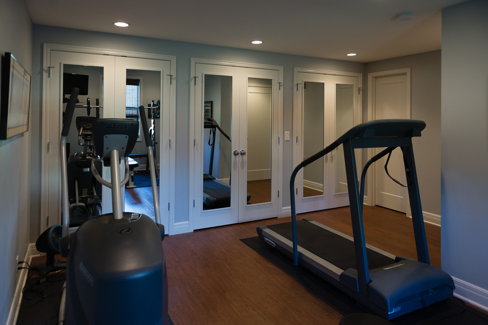 The exercise room got a face lift with mirrored doors.  www.saranobledesigns.com