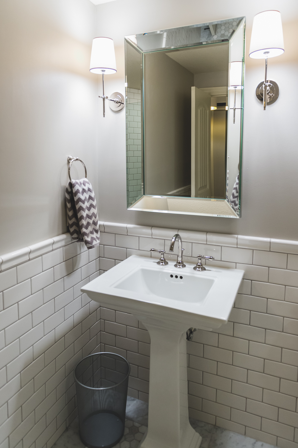 The classic bathroom is a perfect addition for the space. www.saranobledesigns.com
