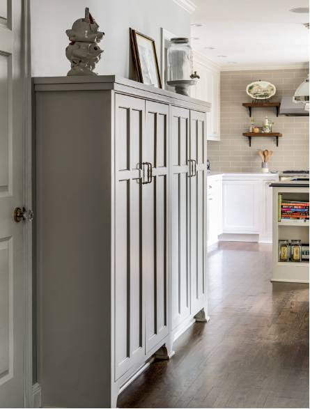 The grey painted cabinetry was designed to work as their pantry in the new kitchen.
