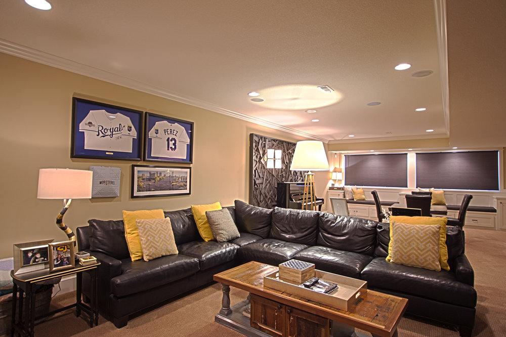 The project continued to the finished basement where we showcased their love for local sports.  As a K-State fan this pained me a little but good design won :)