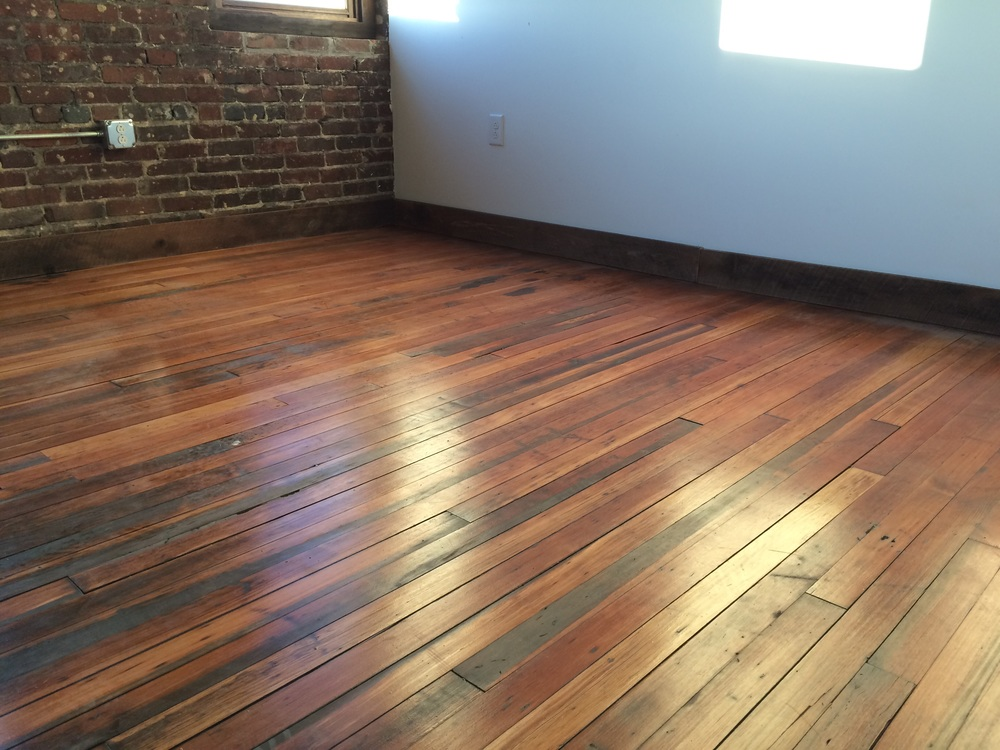Heart pine flooring and exposed brick