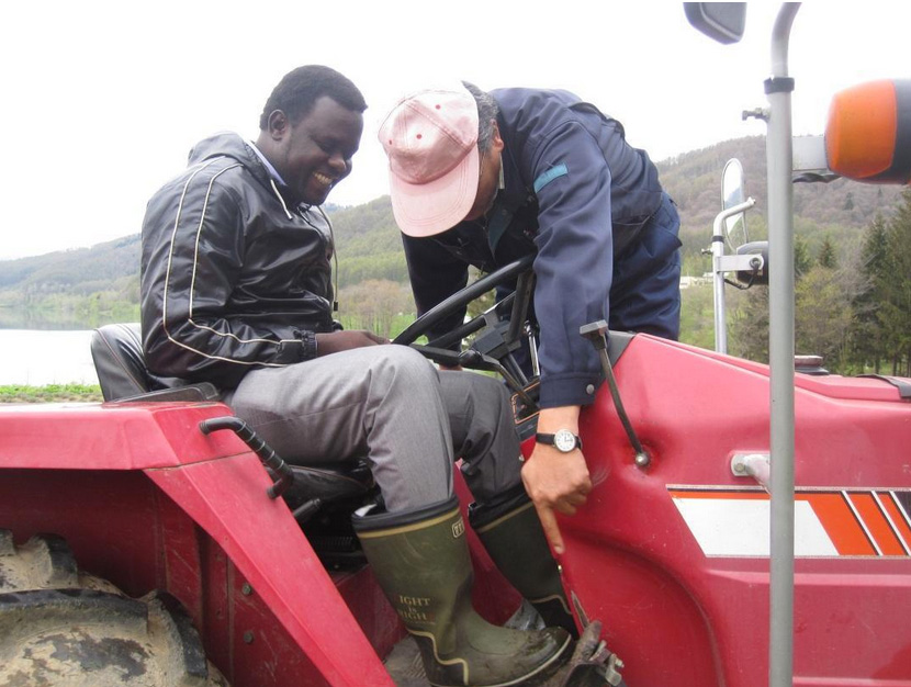 David Nyuol Vincent and Shu Ono (President of Grand Slam) teaching how to use the tractor in a Lavender Farm in South Furano, Japan