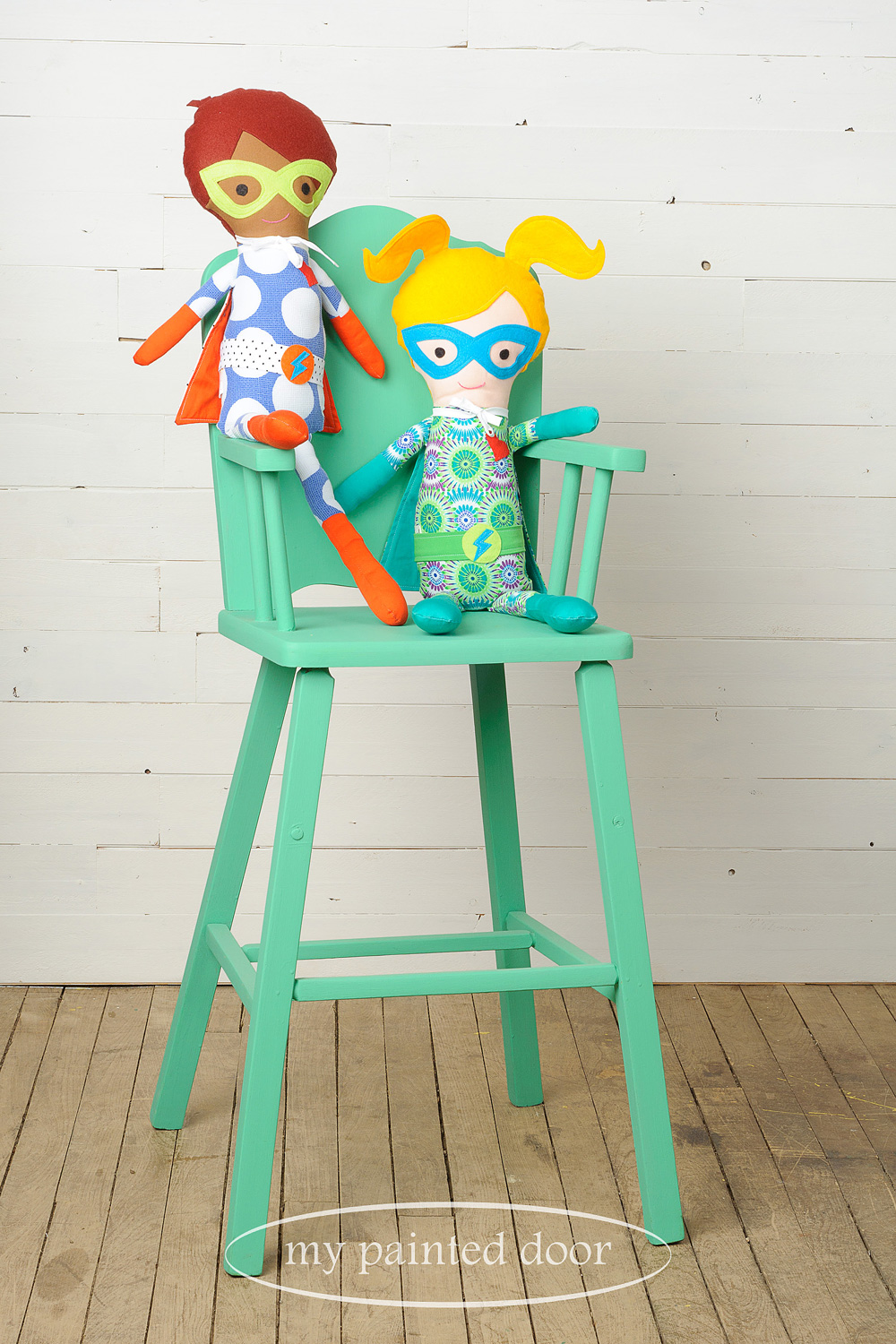 Chair painted in Fusion Mineral Paint in the colour Ceramic and superhero dolls by  Sew Whimsical by Katie  - via My Painted Door (.com)
