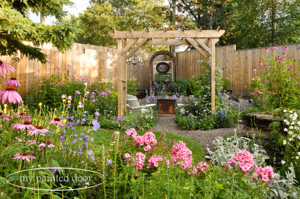 My Country Garden - Sue Sikorski's zone 3 garden - garden arbour with chandelier.