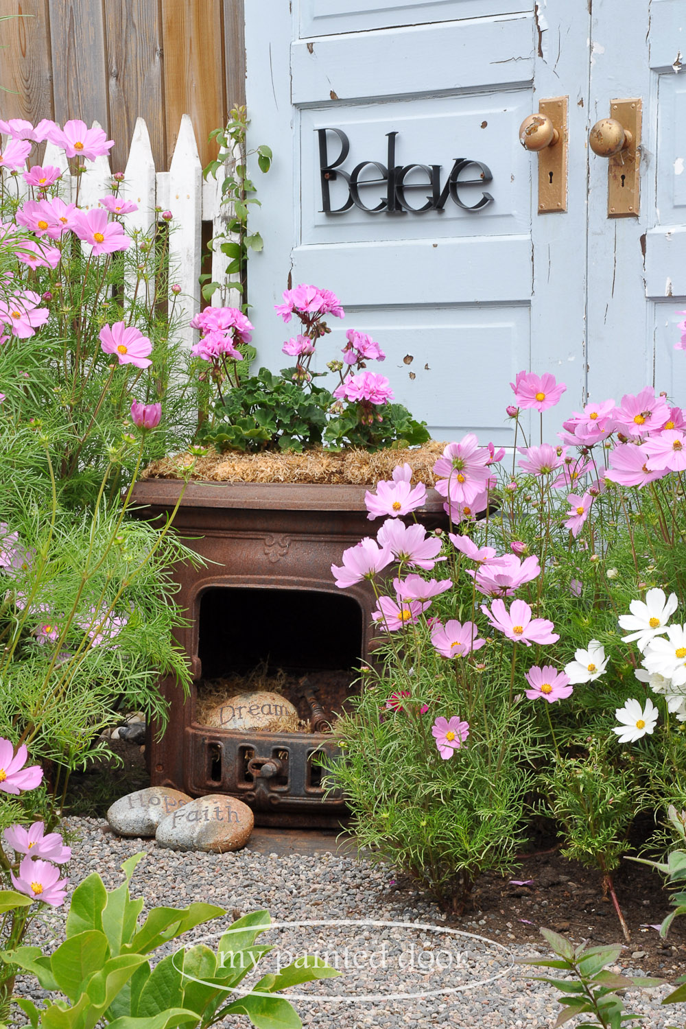Antique firebox in front of repurposed doors