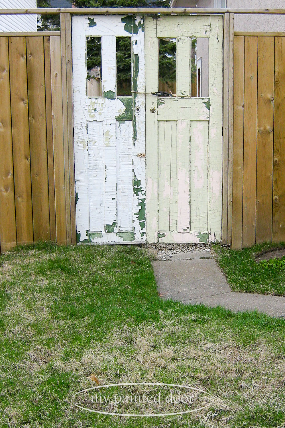 before shot - old doors as a garden entranceway