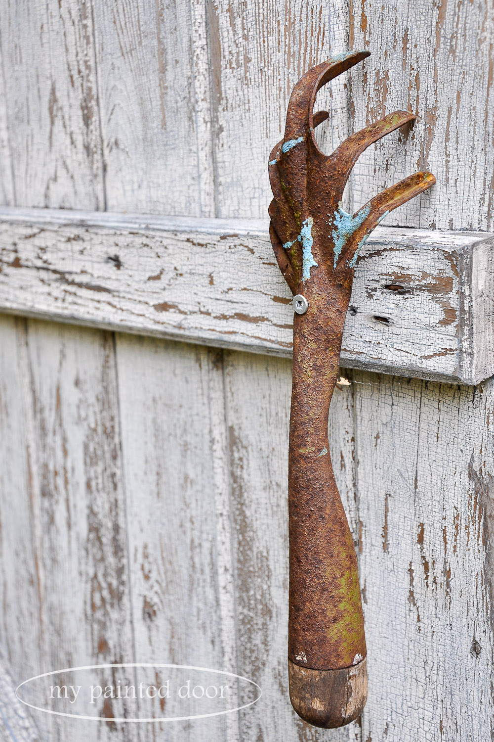 Repurposed doors for your garden - vintage garden tool used as a door handle