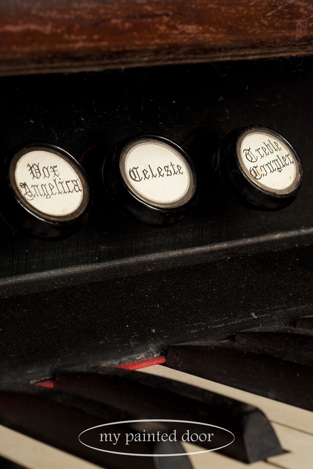 Calligraphy knobs on antique pump organ