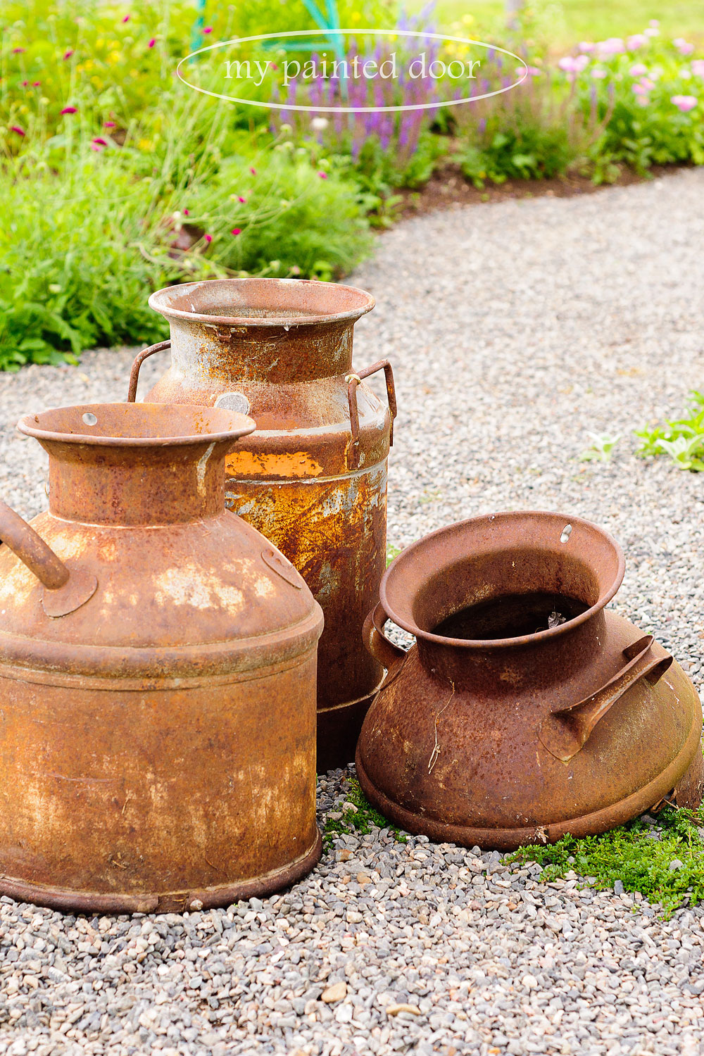 Rusty milk cans - perfect for my garden.