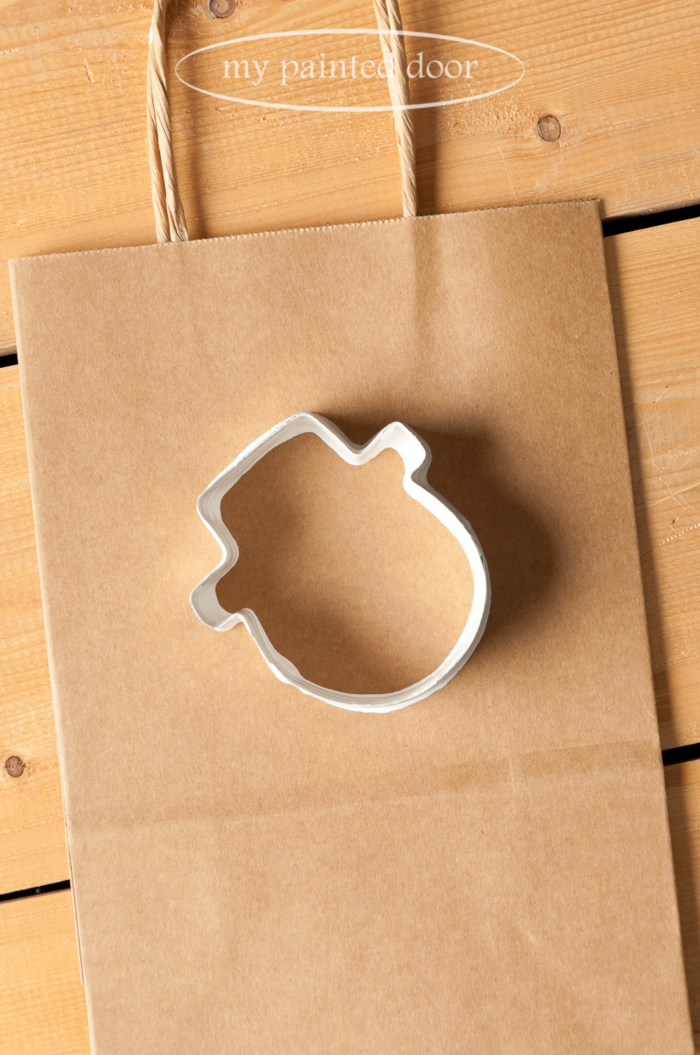 Cookie cutters dipped in Fusion Mineral Paint is a simple way to decorate gift bags for the Holiday Season.