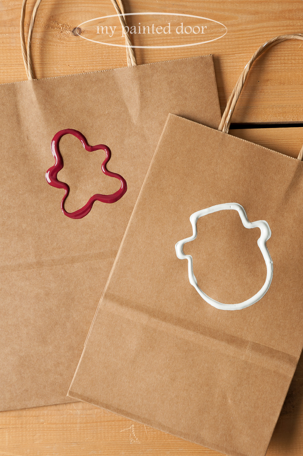 Cookie cutters dipped in Fusion Mineral Paint is a simple way to decorate gift bags for the Holiday Season. We used the colours Cranberry and Casement.