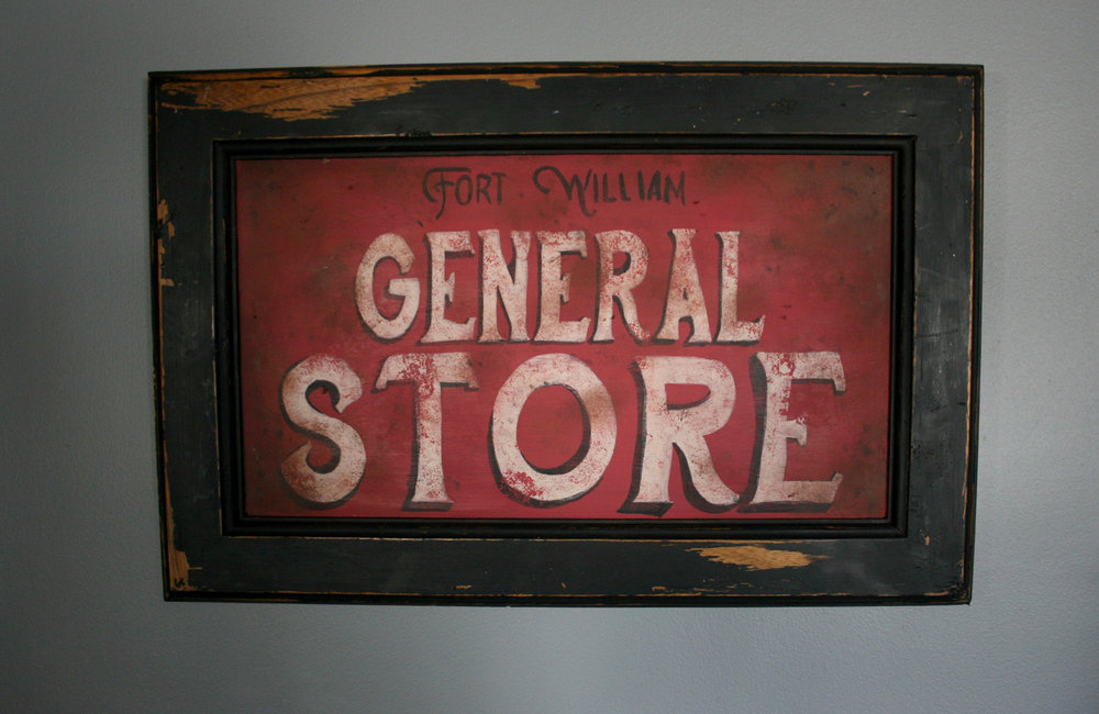 Sign painted by Joanne Malicki of Thunder Bay, Ontario. Joanne is the owner of Wild Mustang Studio by Joanne Malicki.