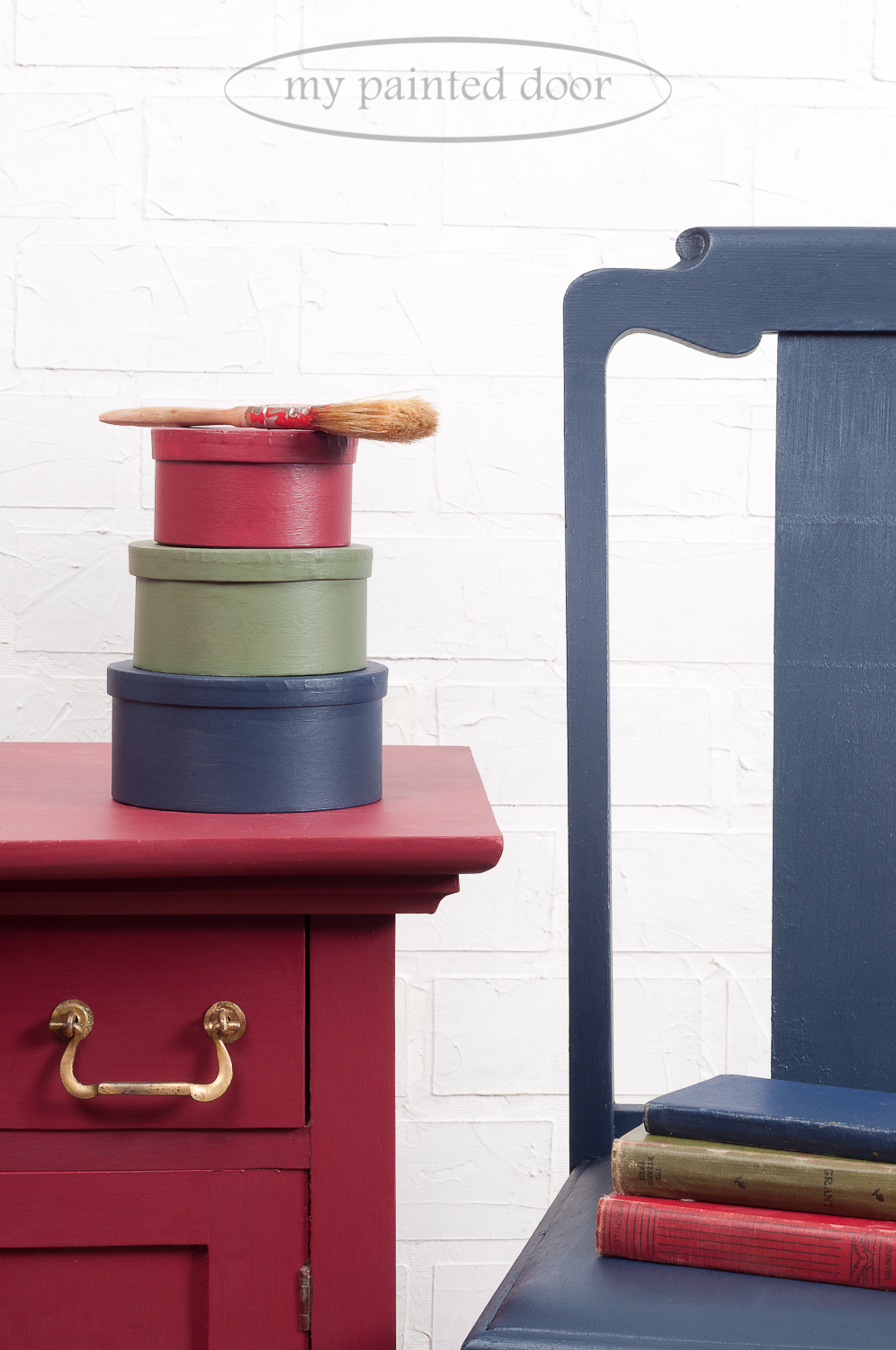 Fusion Mineral Paint in the colours Cranberry, Bayberry and Midnight Blue. Washstand is painted in Cranberry, chair in Midnight Blue and boxes in all three colours.