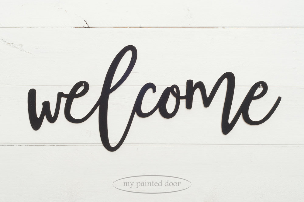 "Wooden laser cut word ""welcome"" painted with Miss Mustard Seed's Milk Paint in the colour Typewriter."