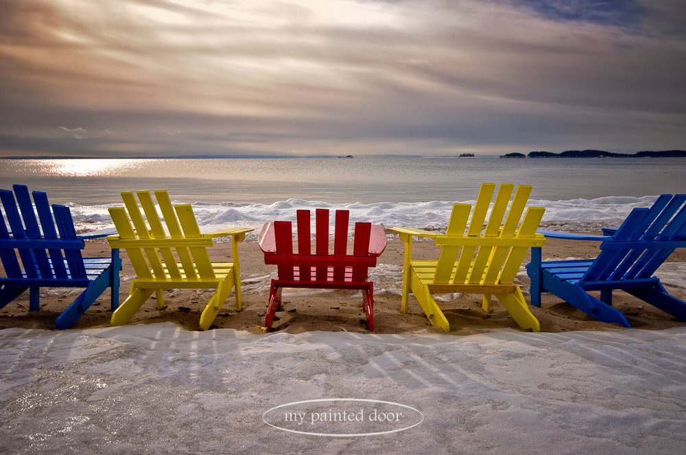 Painted adirondack chairs on the shores of Lake Superior. Photography by Sue Sikorski