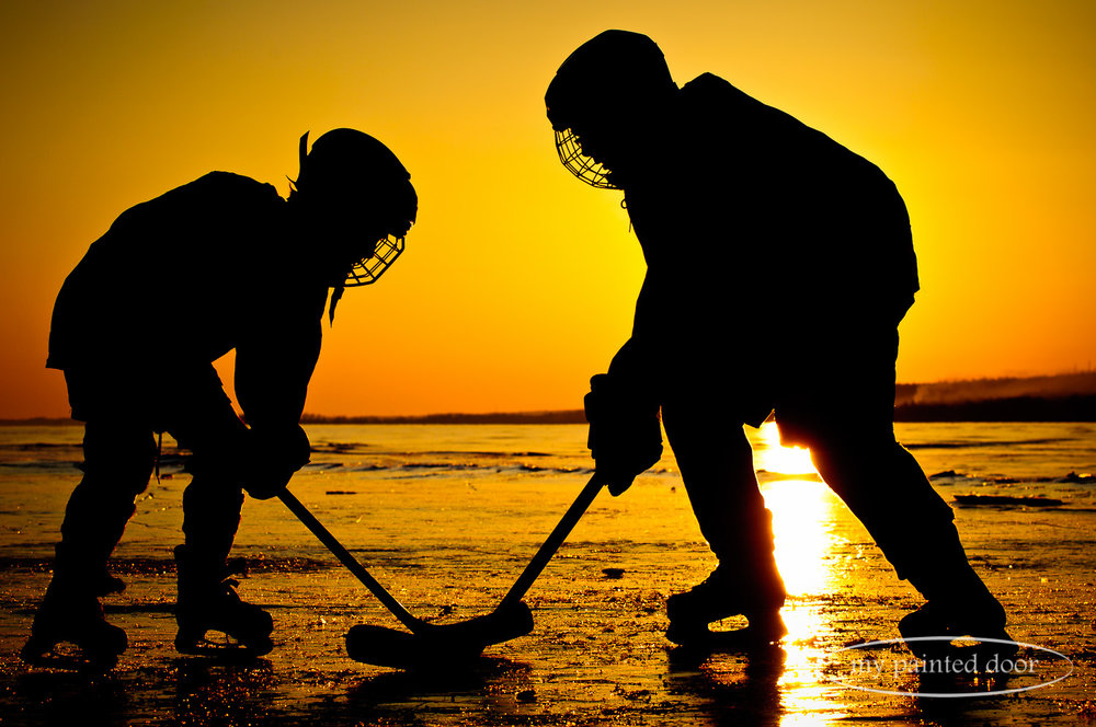 Playing hockey on Lake Superior - Thunder Bay, Ontario. Photography by Sue Sikorski