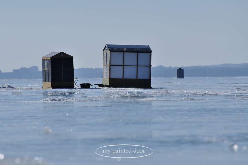 Ice fishing huts on the shores of Lake Superior. Photography by Sue Sikorski